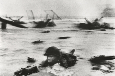 Huston Riley at Omaha Beach, 1944. Photo by Robert Capa.